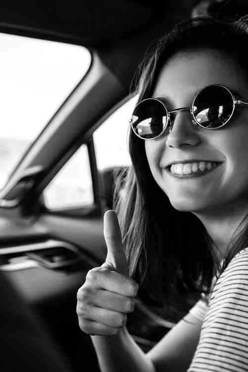 thumbs up from a girl in a car on the Sunshine Coast