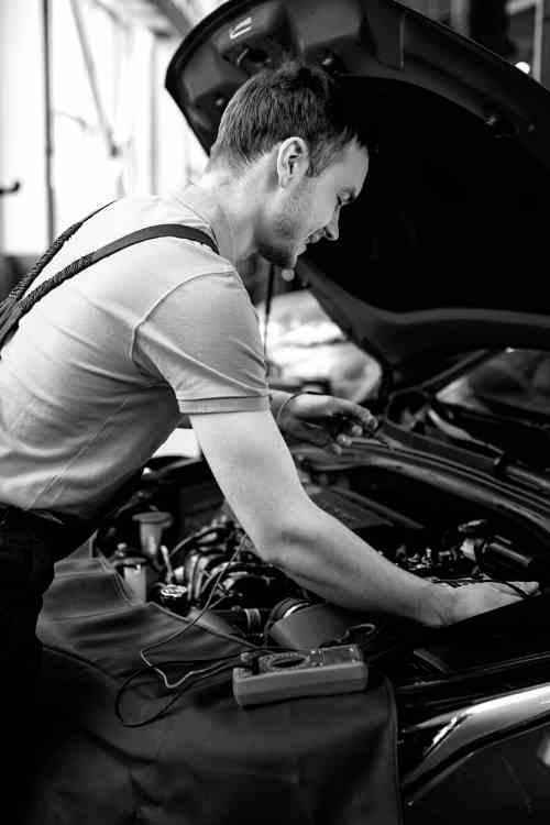 Auto Electrician Sunshine Coast working on a car